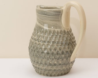 Hand Carved Pitcher