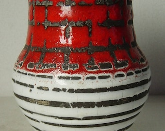 red lava glaze pottery vase with white and black stripes