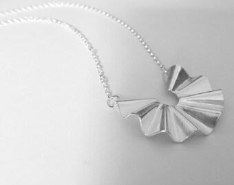 Sterling silver fold pendant.