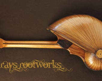 Nautilus Shell back baritone ukulele.  by Rays Rootworks. Handcrafted playable art.