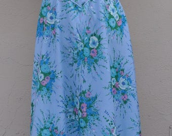 long romantic ceremony dress fabric polyester flowers blue sky background
