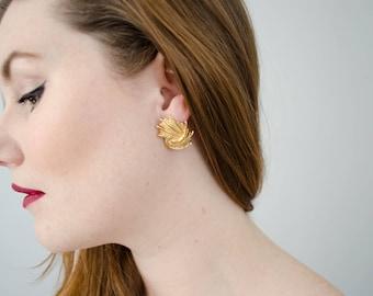 vintage textured gold wave earrings   pierced ears