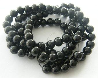 105 Black  glass beads B140