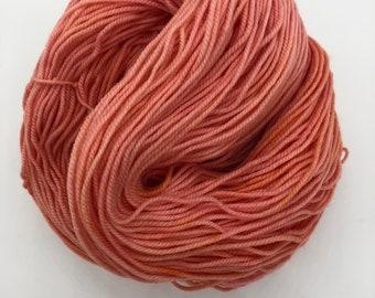 Coral 4ply hand dyed merino nylon sock yarn 100g