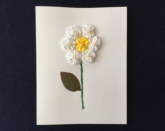Greeting Card with a White Flower Design