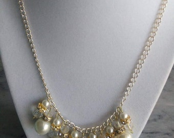 Pearl and Crystal Necklace with a gold tone chain