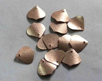 75 metallic peach skin  color/grainy texture/ petal shape sequins / KBIS696