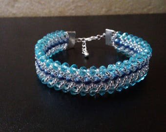 Blue Crystal and mother of Pearl flat spiral bracelet