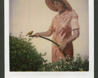 Vintage SX 70 Polaroid Color Snapshot Photo Outdoor Mural Woman Holds Hose with Bird 1980's, Original Found Photo, Vernacular Photography
