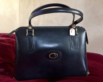 Black Vintage leather bag in the 60s