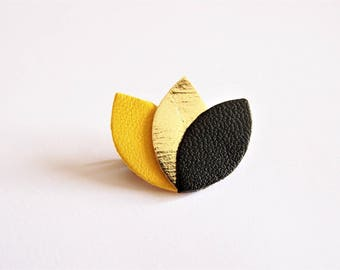 Brooch yellow, gold and black leather petals
