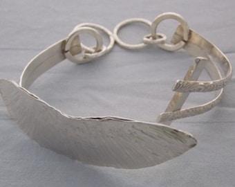 Fine and sterling tension bracelet