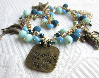 Blue beaded ocean bracelet, dreaming of the sea, with dolphins, a turtle, seahorse and sea star charms