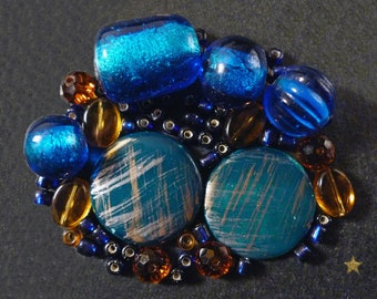 Amber of various shapes, green and blue lampwork glass beads
