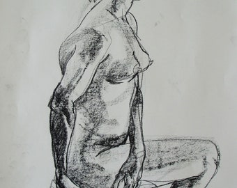 Conté crayon life drawing of a woman sitting on a cushion