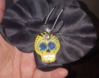 Black orchid with yellow sugar skull