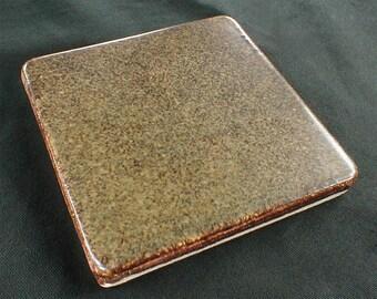4x4 field tiles in semi-gloss mottled brown glaze, fireplace surround tile, kitchen tile, bathroom tile