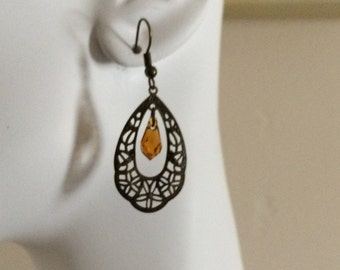 Topaz Swarovski faceted tear drop crystal with Brass floral lazer lace focal.