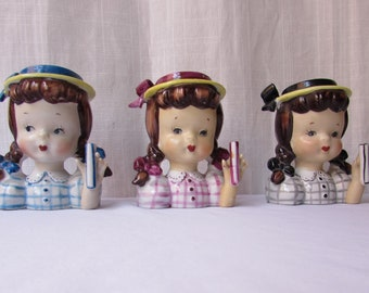 THREE 1950S HEAD VASES Girls with pigtails. Blue  pink black dresses