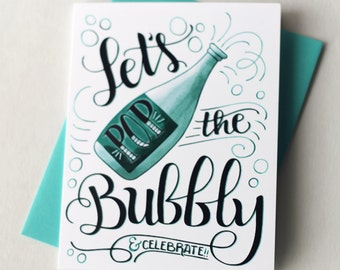 Lets pop the bubbly and celebrate  - one card with a turquoise envelope