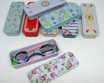 Knitters tool tin including notions and folding scissors