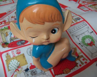 adorable crying elf figurine