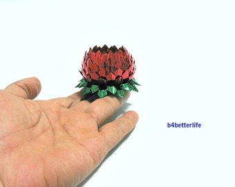 A piece of Small Size Red Color Hand-folded Origami Lotus. (4D Glittering paper series).