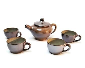 Tea set in enamelled stoneware , vintage