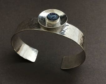 Hammered silver cuff with purple dichroic glass