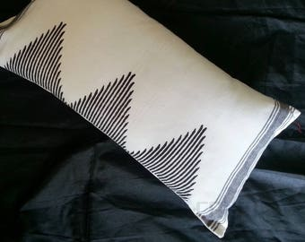 A White decorative lumbar pillow