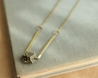 pyrite necklace with brass bars on long chain