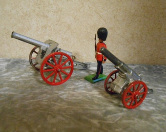 1950's Metal British Soldier & Two Metal Canons