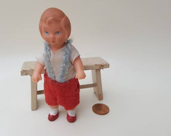 Old East German vintage baby doll to the doll's House