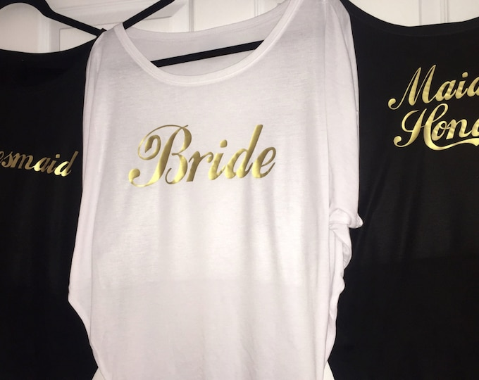 15 bridesmaid shirts . Bridesmaid loose flowy t-shirts. Bride, Maid of honor. Bridesmaid gold writing shirts . Bridal party oversized tops.