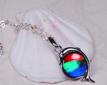 Ammolite pendant.Lovely porpoise themed setting.Perfect for the ocean lover.#112017
