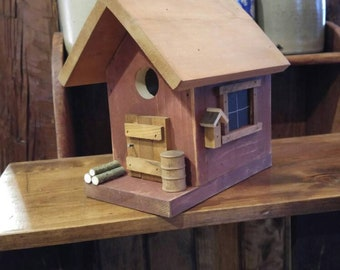 Rustic red birdhouse.