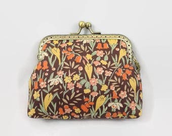 retro coin purse closing bronze metal design at bottom Brown printed flowers yellow and orange
