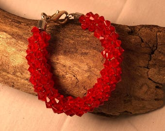 Kumihimo red crystal bicone bracelet with silver clasp