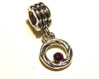 One (1) Rhodium-Plated Wreath and Garnet Big Hole Charm --- Lot UU