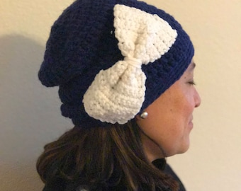 Handmade blue crochet hat with large white bow