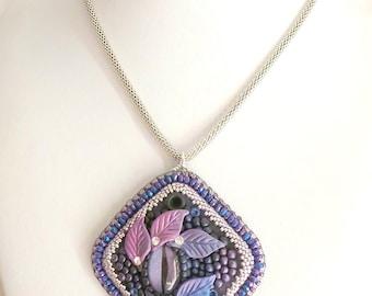 Embroidered purple dragon eye pendant