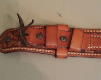 Vintage western leather belt stamped with acorns and oak leaves