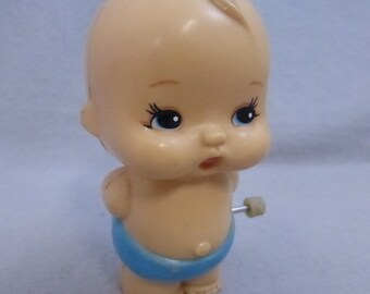 Vintage Tomy Wind Up Baby Toy
