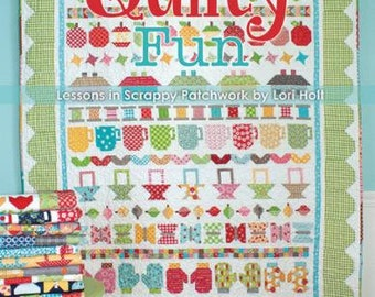 Quilty Fun Pattern Book by Lori Holt featuring Bee in my Bonnet Row Along Quilt, including 10 more quilt projects.