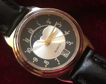 Womens Watch, Gold Bezel, Silver and Black Dial, Gold Hands, Moon Phase between 10 & 2, Date Window at 6, Black Leather Band, Working Great