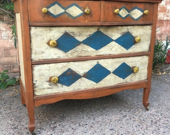 Antique Serpentine Oxbow Hand Painted Distressed Harlequin Diamond Four Drawer Dresser on Casters