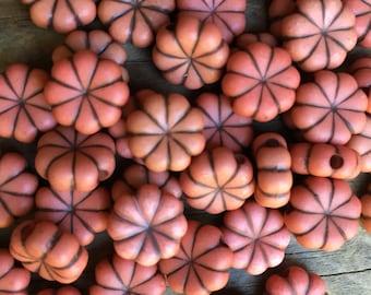 12 plastic flat pumpkin shape beads orange