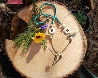 """Jack rabbit Vertebrae and pink Tourmaline stone """"tassel"""" also with White Jade, Green Kyanite, Moonstone, and Tigers Eye on colored leather"""