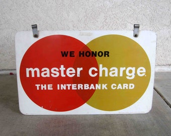 "Vintage ""We Honor Master Charge / Mastercard"" Metal Sign. Circa 1960's."