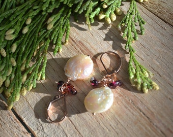 Pearl coin and garnet dangle earrings on gold leverbacks.
